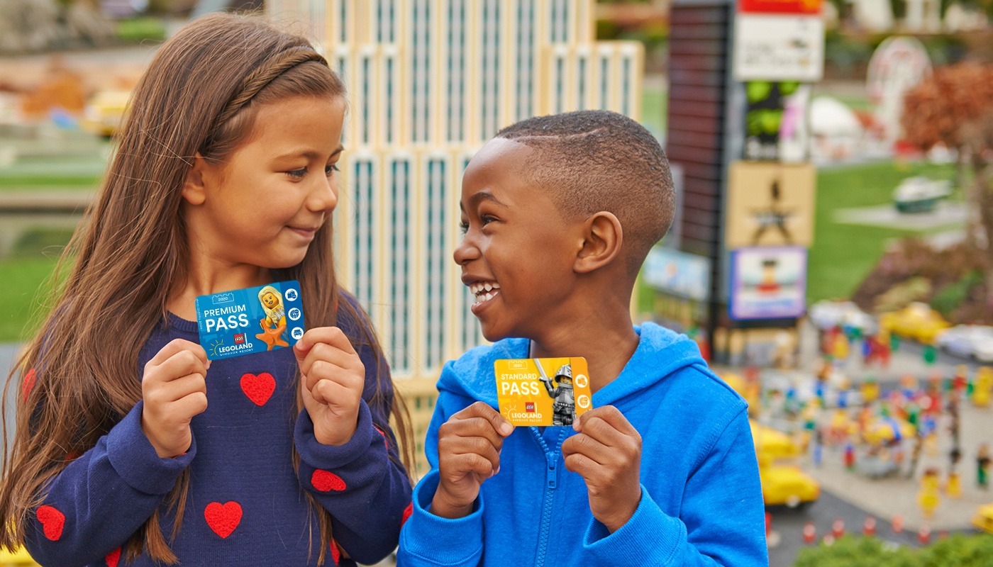 Children holding LEGOLAND Annual Passes